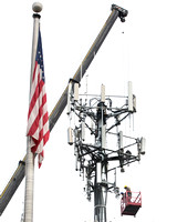 Technicians work on cell tower in Hamilton