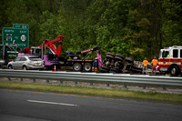 Dump truck careens across I-295, rolls over, jams traffic