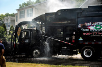 Lawrence firefighters extinguish garbage truck fire