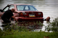 Woman rescued from car in river