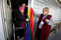 Church dedicates replacement for stolen gay pride flag