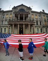 Huge American flag unfurled at State House