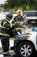 Trenton firefighters extinguish a car fire on S. Broad St. at Fu