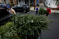 The Lambertville Public School 6th Grade offers Christmas tree pick-up service