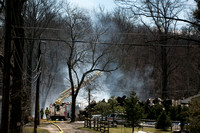 Woodpile burns in Lawrence