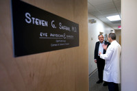 Chief judge travels from Australia for local eye surgeon