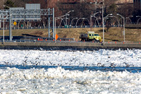 Water flows in the icy Delaware River