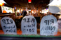 Students from Our Lady of Sorrows School paint Halloween onto windows at Applebee's in Hamilton
