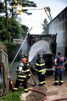 Truck fire spreads to building in Mansfield