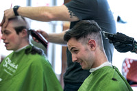 Assemblyman shaves head for charity